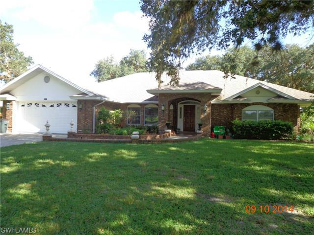 1490 riverbend dr labelle fl mls 214050139 southern for Garage door repair lehigh acres