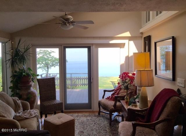 Image is of a lake view from inside the below described waterfront home for sale on Lake Michigan in Stevensville, Michigan.