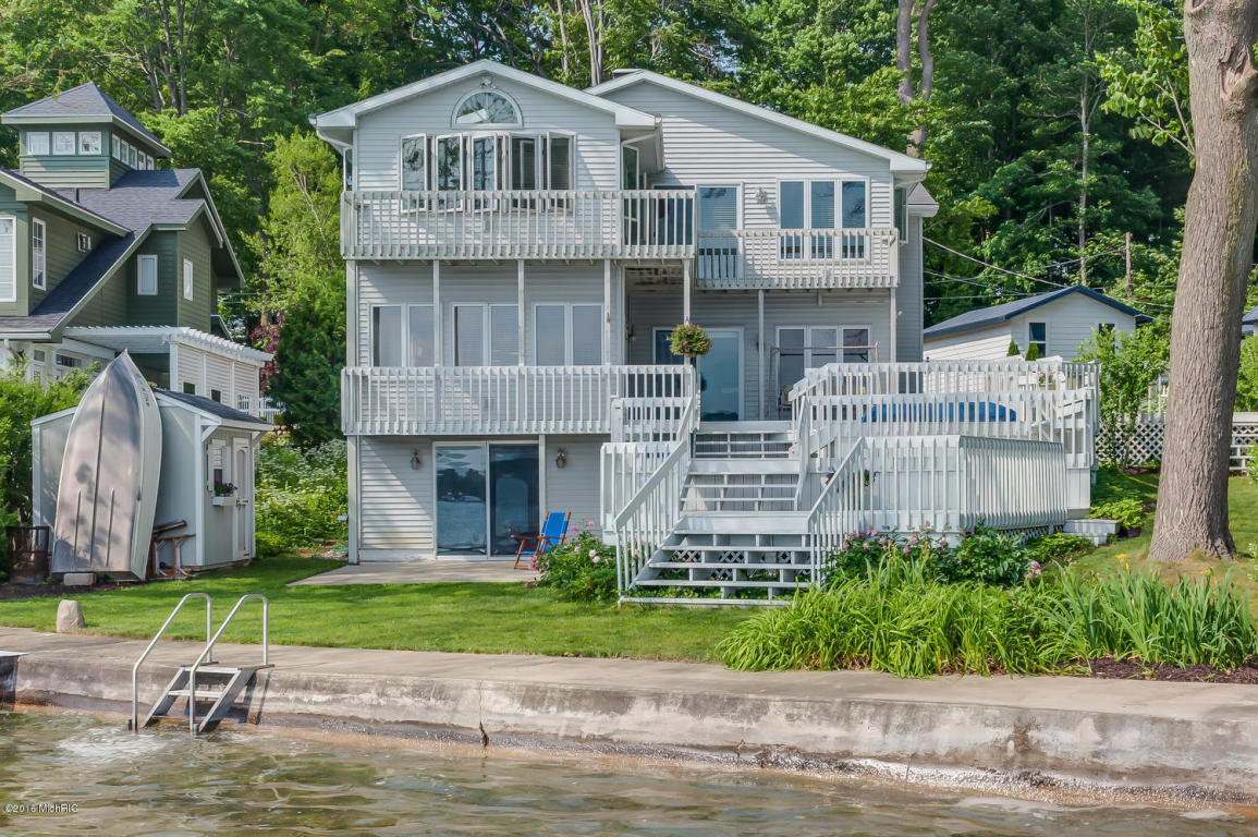 Image is an exterior shot of the described home for sale on Diamond Lake in Cassopolis, Michigan.