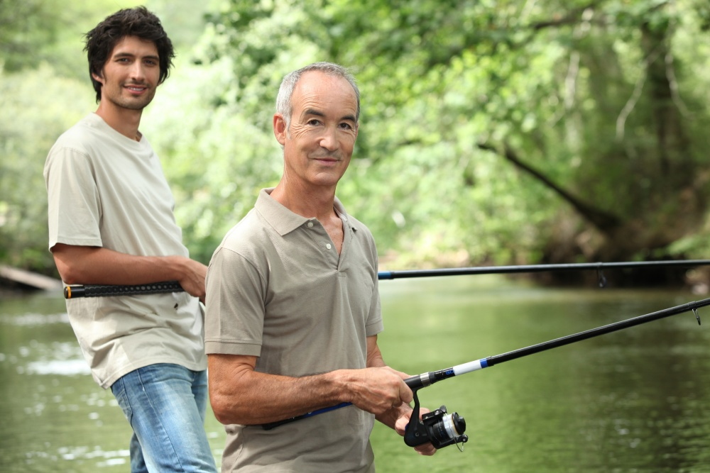 Son and father enjoy fishing