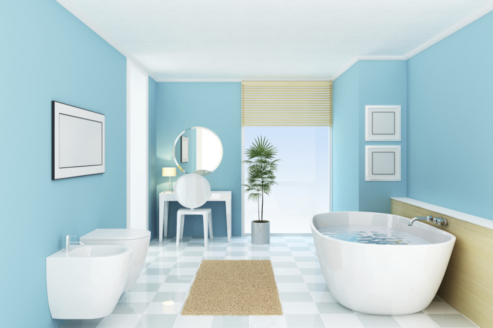 Bathroom with light aqua walls, mounted on wall sink and toilet, freestanding oval modern tub and checkerboard white and gray tiles for the floor