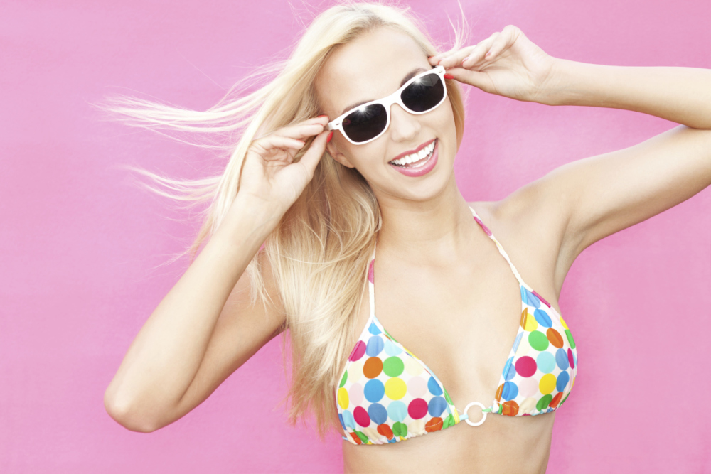 Pretty Blonde Model In A Swimsuit Smiling