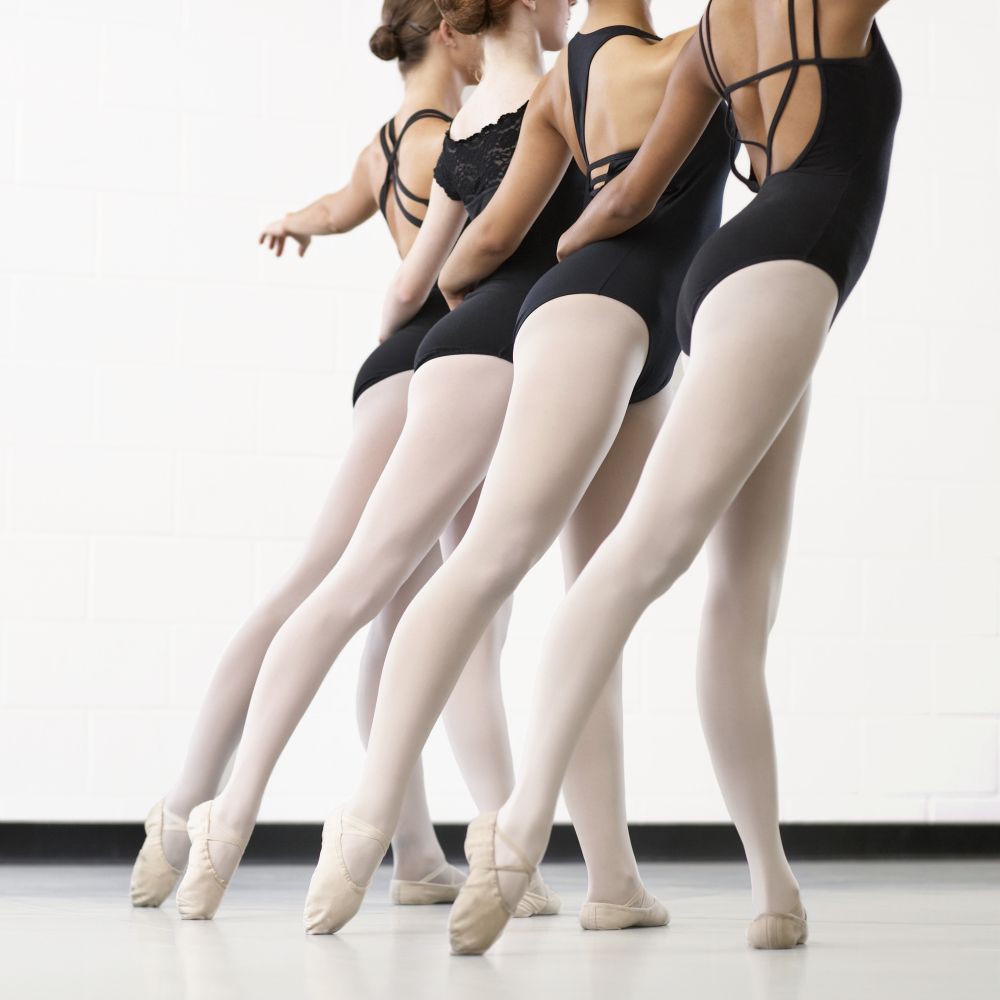young adult women at a ballet class