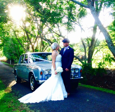 Bride and Groom next to a classic Rolls-Royce wedding car