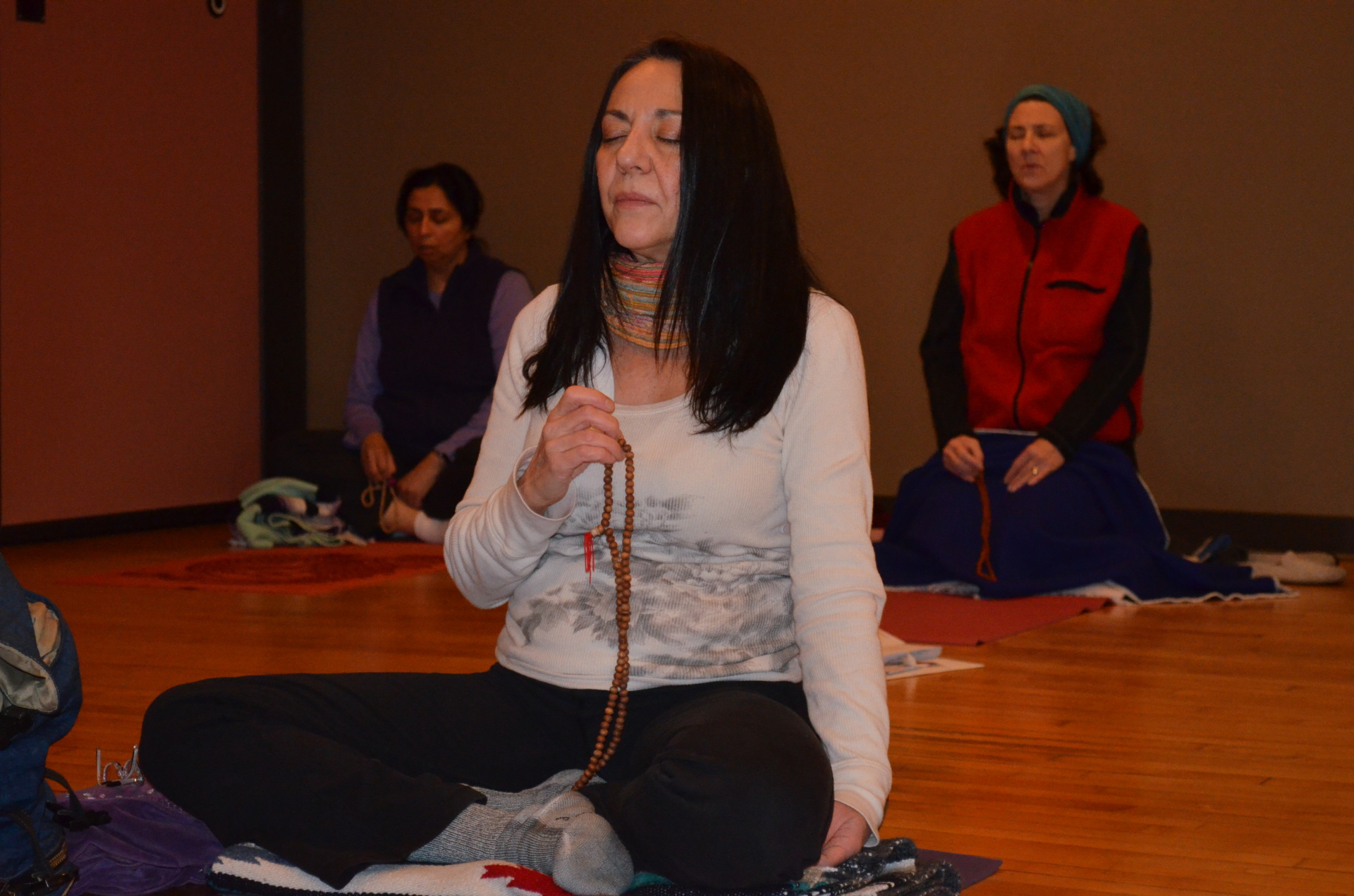 YANA student meditating with mala