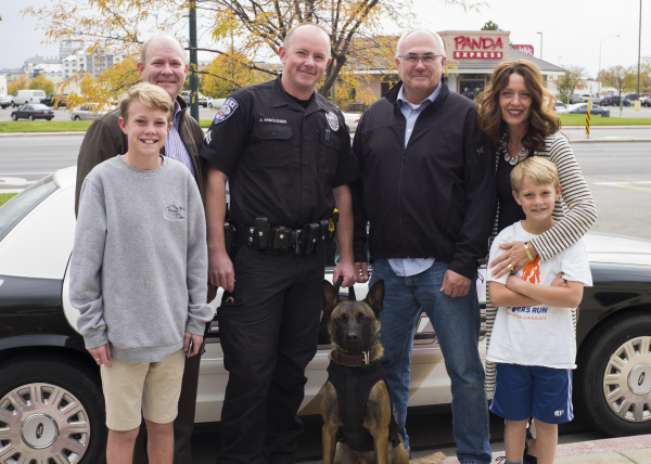 """Kofford Family with K9 """"Cooper"""" wearing his K9 Storm Patrol Swat Vest"""