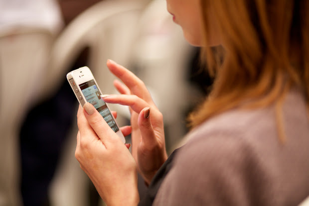 product managers networking on mobile device