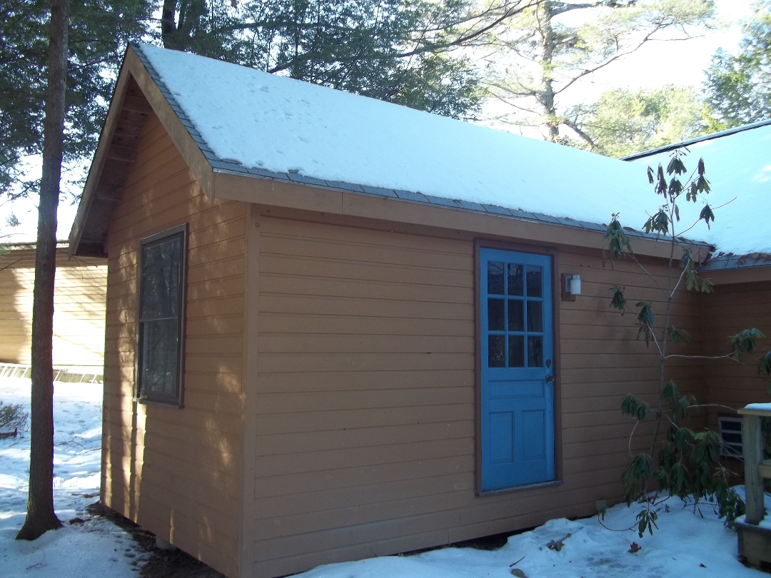 Wiscasset Woods bike shack has bicycle storage, a bike repair stand, fridge, maps and info