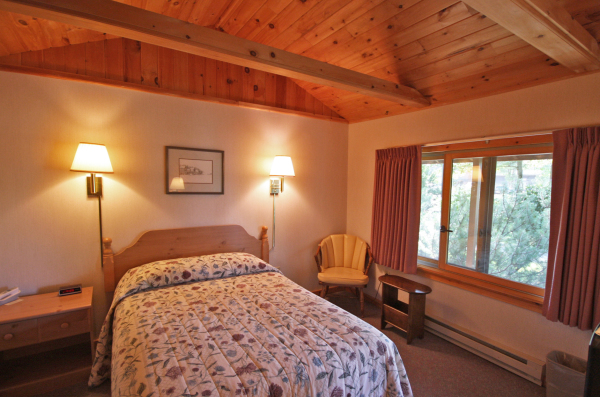 Beautiful cottage hotel rooms with handmade woodwork at Wiscasset Woods