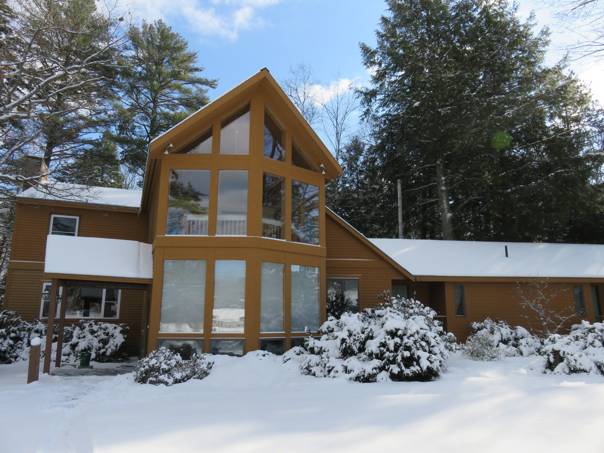Wiscasset Woods Lodge in Wiscasset Maine covered in snow