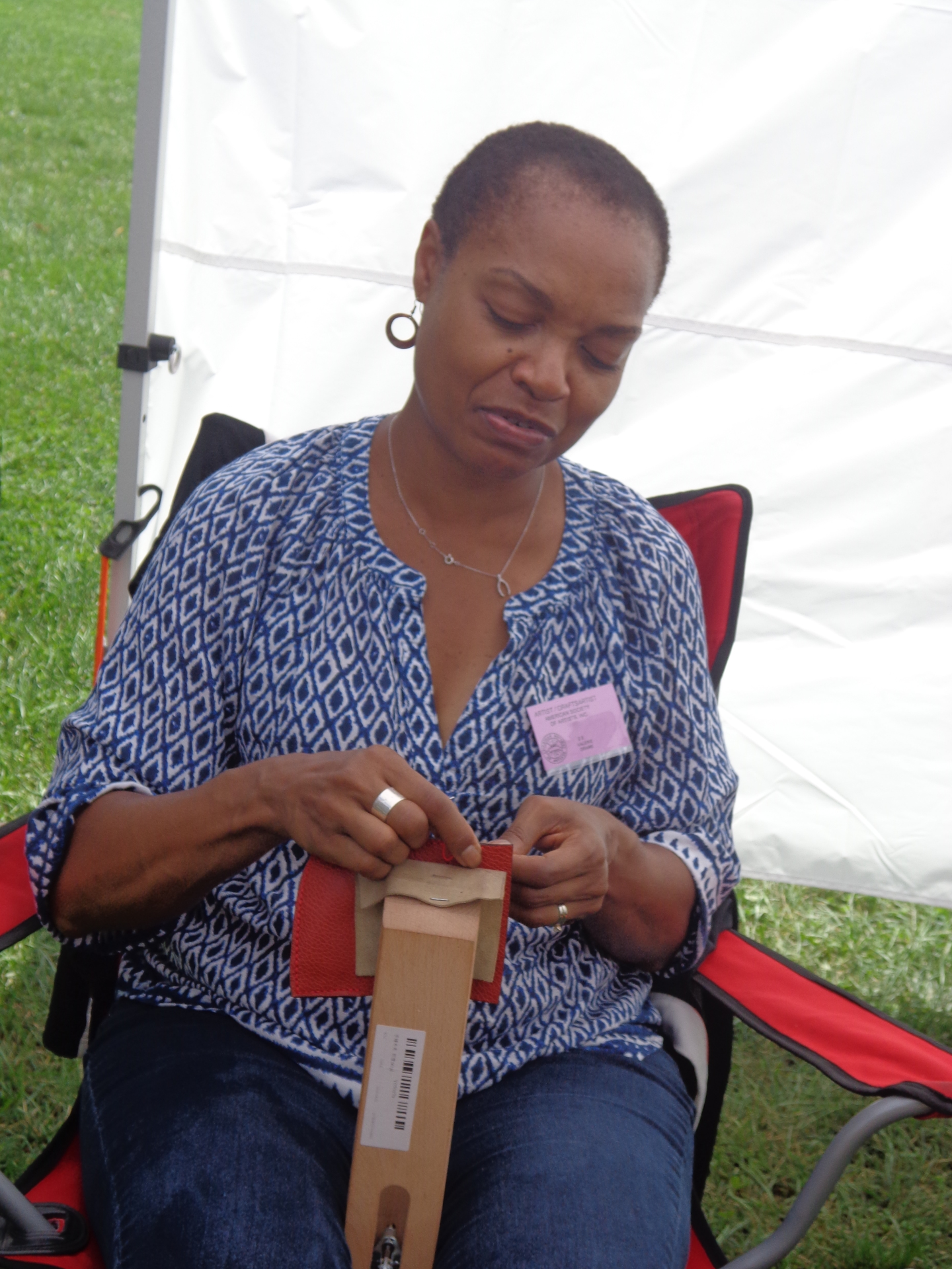 Artist at Work in her booth at show