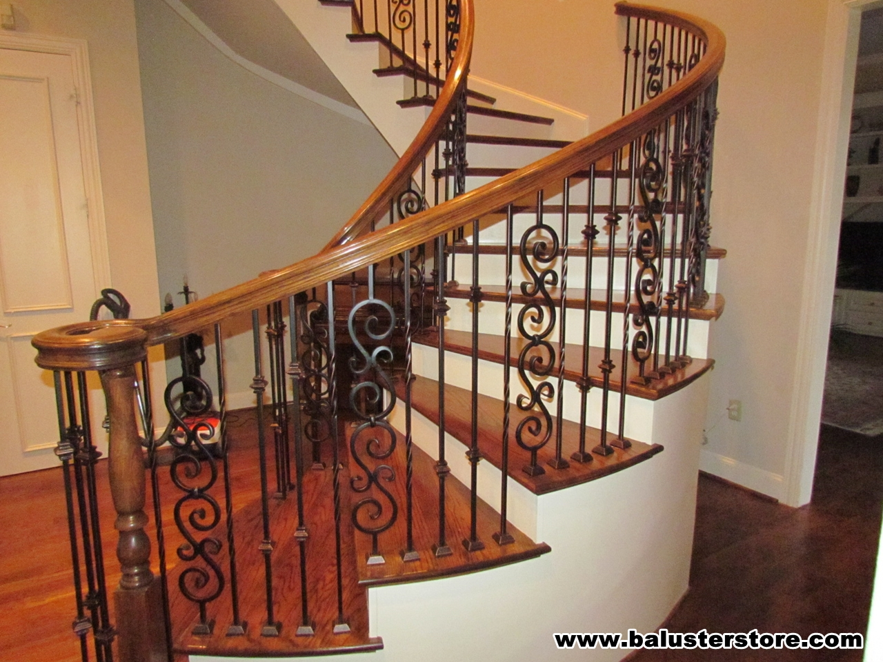Double scroll, double knuckle, double twist .  Stair railing