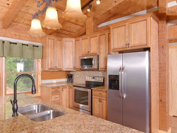 Appalachian Escape inside - kitchen with stainless appliances and chiseled edge granite countertops