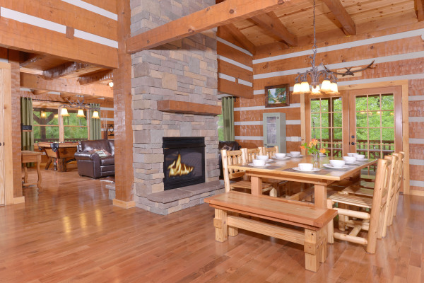 Appalachian Escape cabin inside - fireplace and dining room