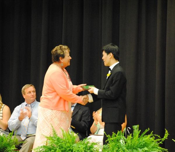 Walter Siv and Larissa Lagria accept their honors at Senior Night.