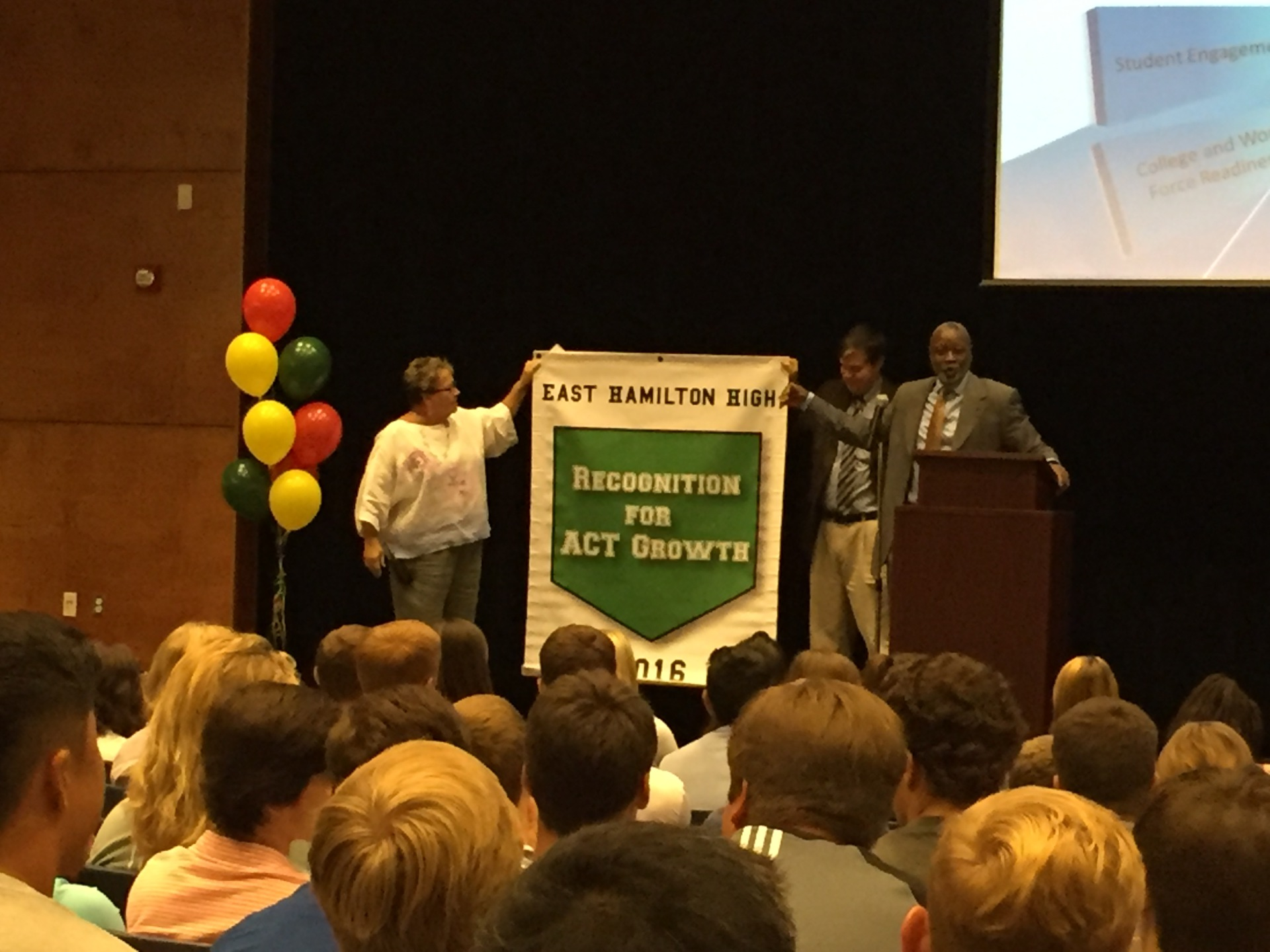 East Hamilton being awarded their banner of recognition for ACT excellence.