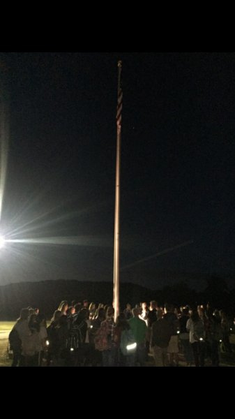 Students and teachers gather around the front flag pole for FCA.