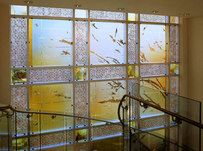 gold and copper leaf on painted glass at an embassy reception hall