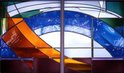 stars, comets and blue heavenly sky in stained glass