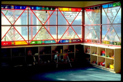 nursery and playroom with colourful, prismatic windows by Sarah Hall