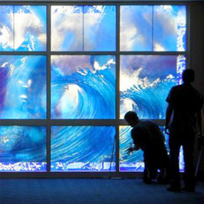 """walking on water"" window being installed shows big waves in ocean blue colour"