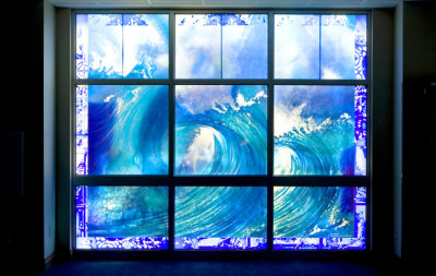 waves and blue water in church window by sarah hall