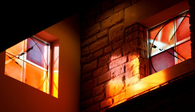 light passes through stained glass windows by Sarah Hall