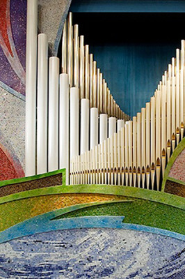 glass mosaic and beautiful white organ pipes like dove