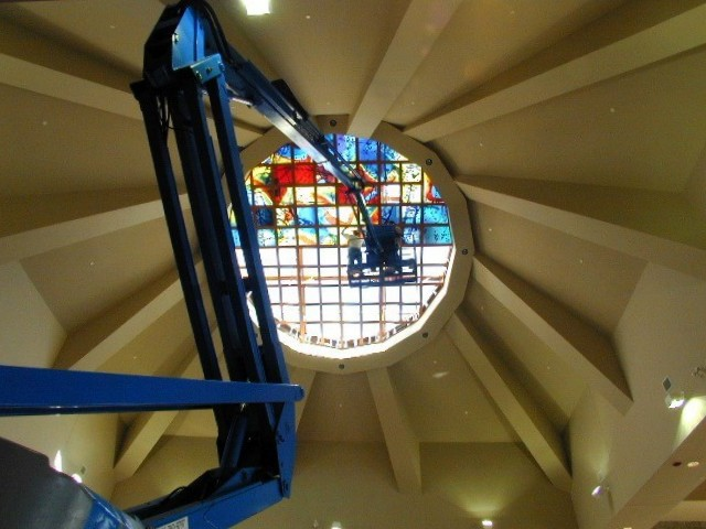 """Camino""  oculus window by Sarah Hall being installed from a cherry picker"