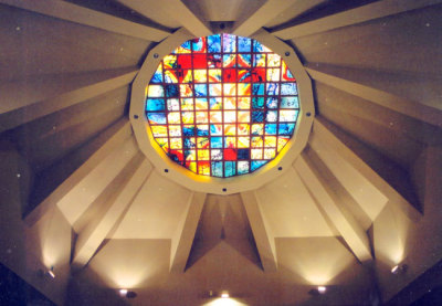 church skylight radiant with warm, colourful light transforming the space