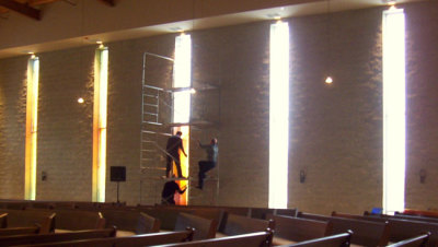 stained glass installation transforms light in church