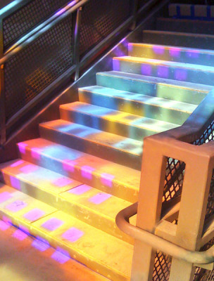 coloured light from Sarah Hall's window floods the main stairwell of the school