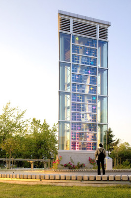 student at UBC looks at solar wind tower by Sarah Hall And Clive Grout