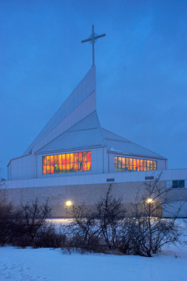 illuminated cathedral windows from outside on a winter's night