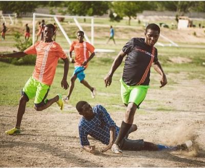 Teaching the kids futbol, teamwork and so much more.