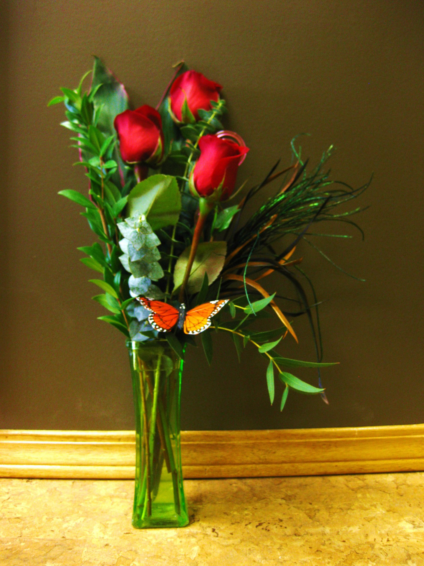 3 roses in a tall vase