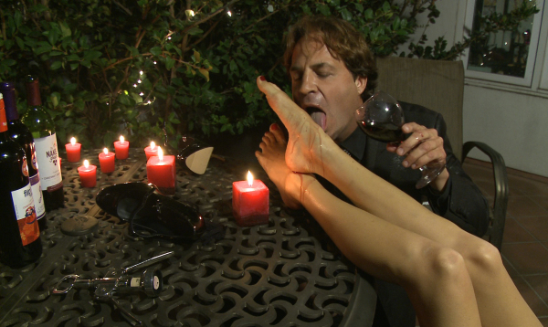 Eric John drinks wine off Holiday Presley's feet