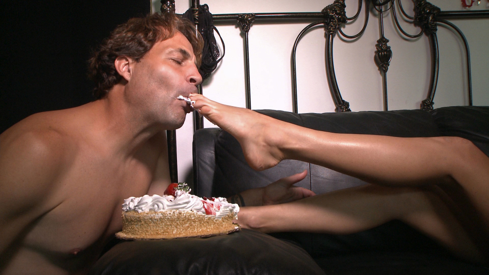 Holiday Presley feeds Eric John cake with her bare feet