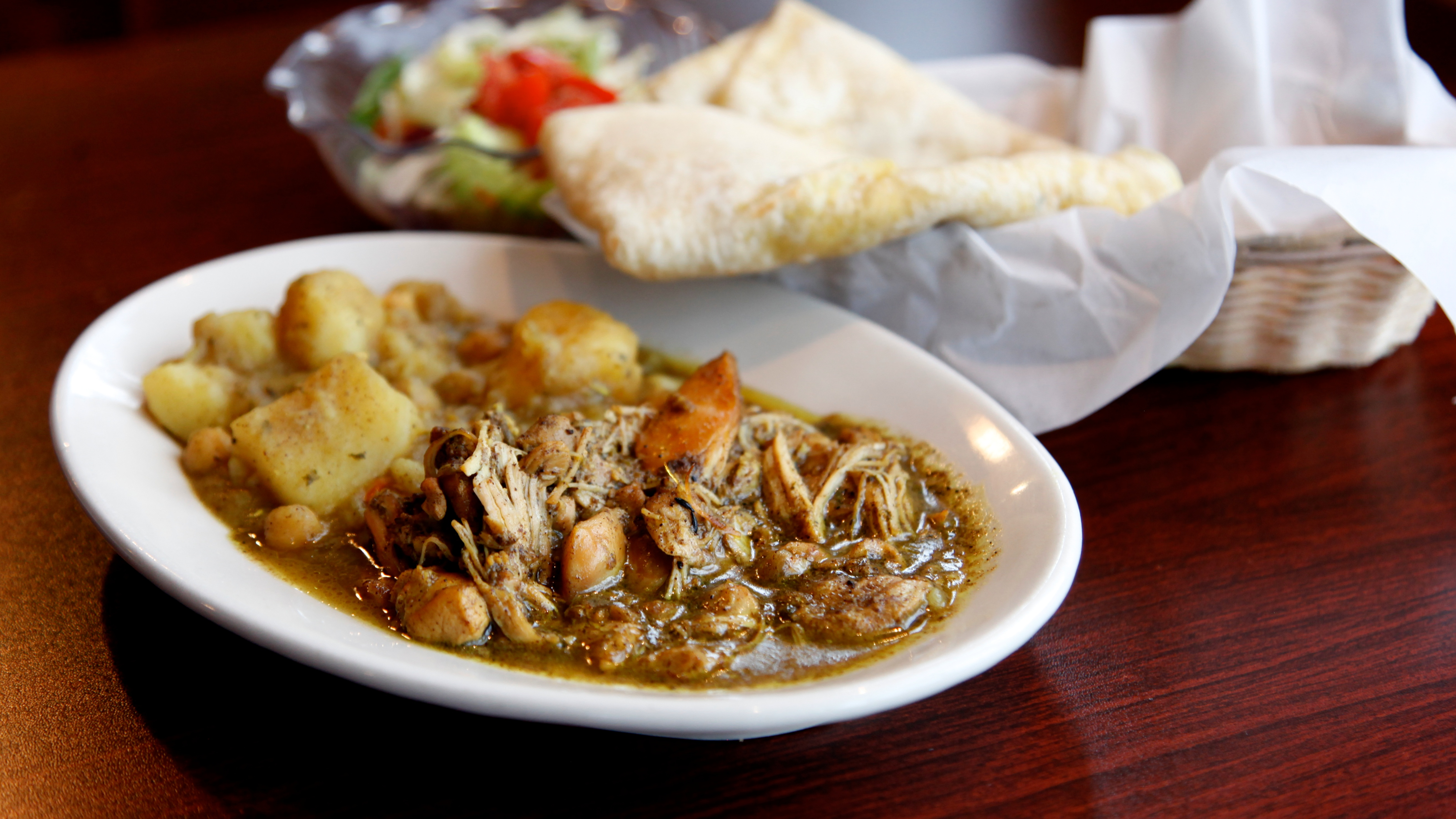 roti is the star at pams kitchen the cheerful caribbean cafe in the u district a soft seasoned flatbread thats a little like naan - Pams Kitchen