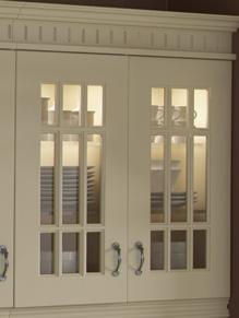Close up of Beaded Prague kitchen doors in Plain Ivory and Dark Walnut