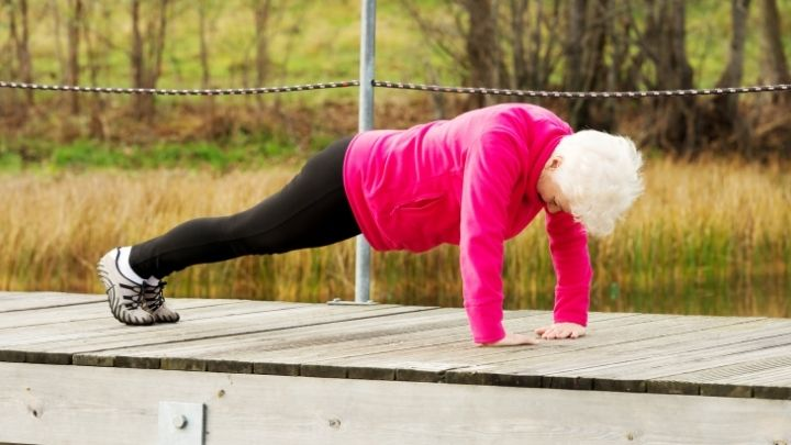 Senior woman working out in the park