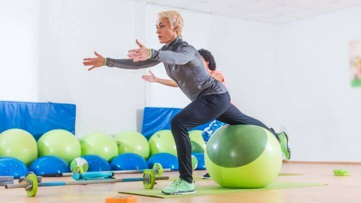 Middle aged woman working with an exercise ball