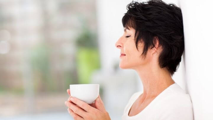 Middle aged woman enjoying a cup of tea