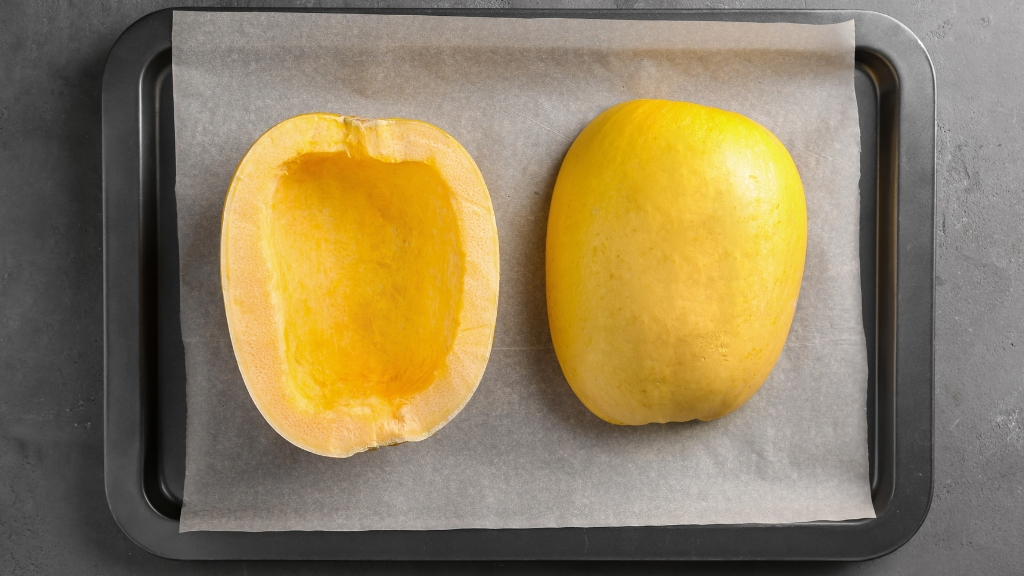 Spaghetti squash ready to be raosted on an oven tray