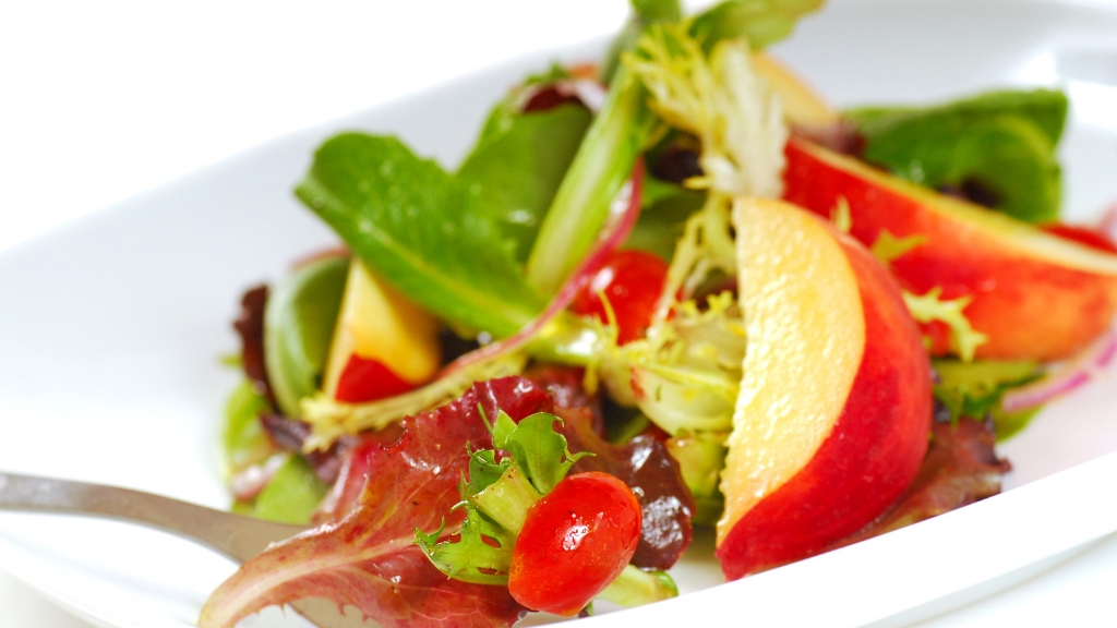 Delicious salad with apples and tomatoes