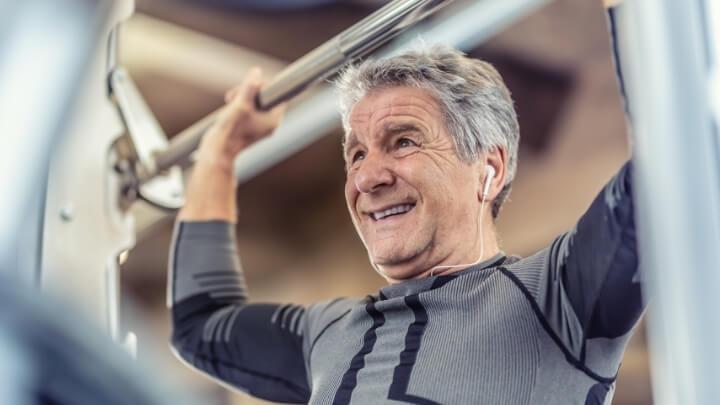 Senior man weight training at the gym