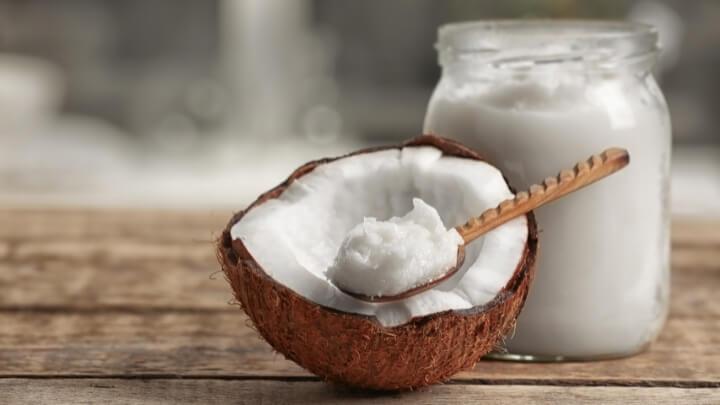 Coconut oil in wooden spoon