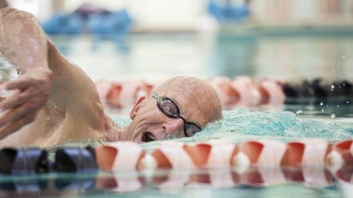 Senior man swimming in a lap lane