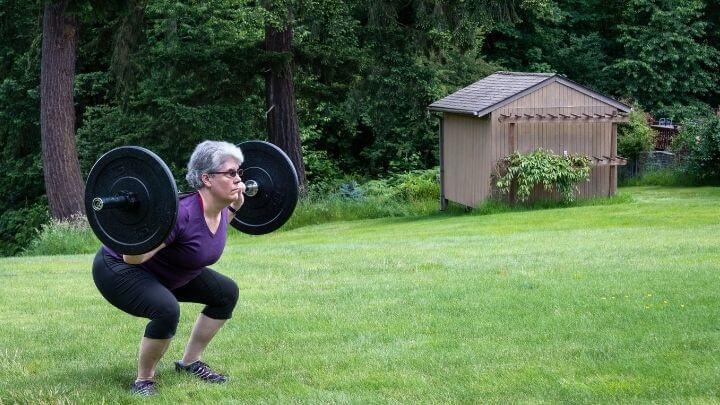 Senior woman strength training in her back yard