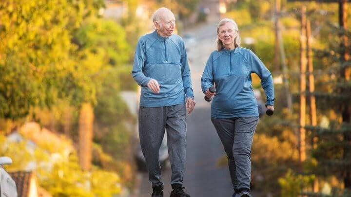 Elderly couple walking to stay healthy